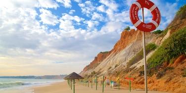 Falesia Beach featuring rocky coastline, general coastal views and a beach