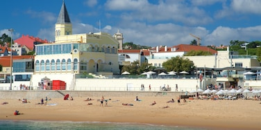 Tamariz Beach which includes a beach and general coastal views as well as a small group of people