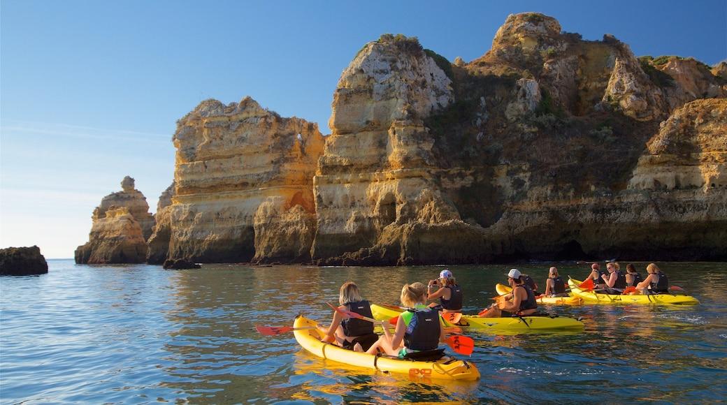 Ponta da Piedade Lagos Lighthouse featuring general coastal views, kayaking or canoeing and rocky coastline