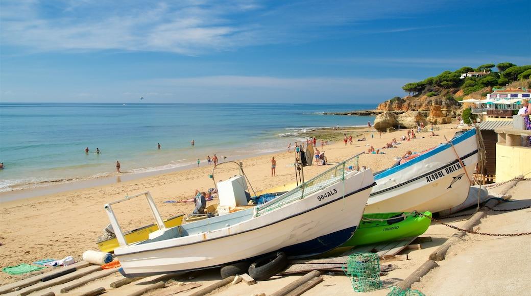 Olhos D\'Agua Beach featuring a beach, swimming and general coastal views