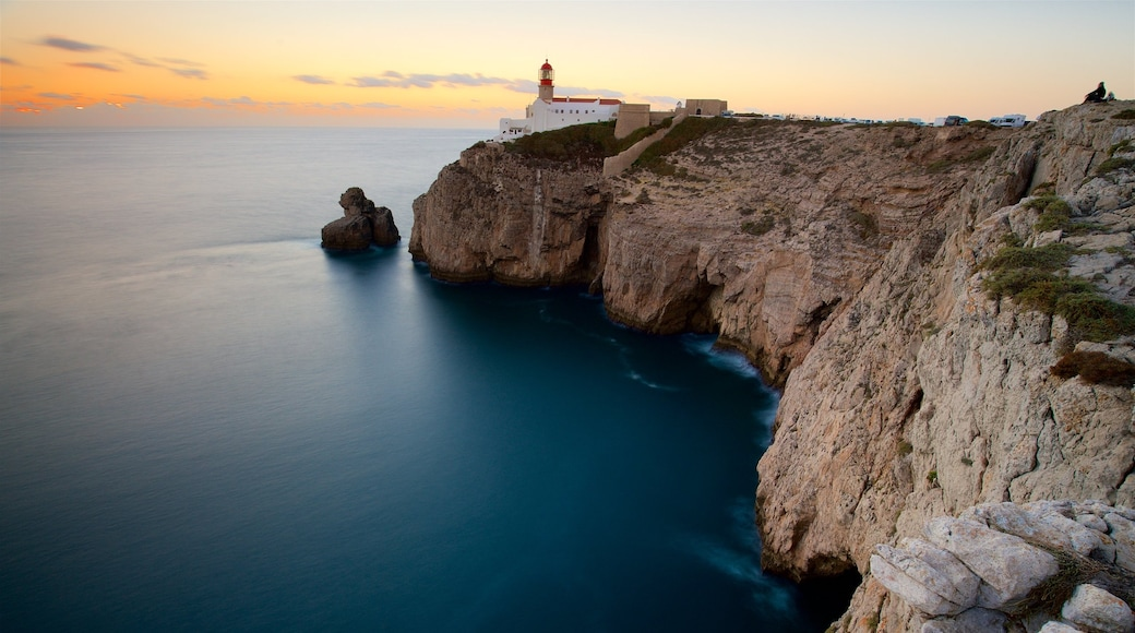Cape St. Vincent Lighthouse showing general coastal views, a sunset and a lighthouse