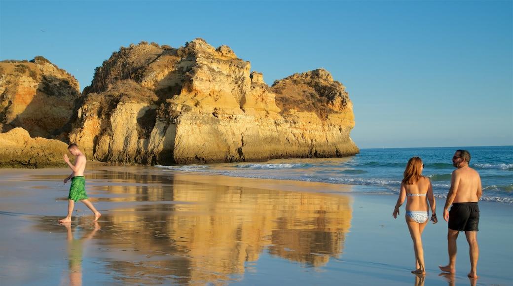 Tres Irmaos Beach which includes a sandy beach, general coastal views and rocky coastline