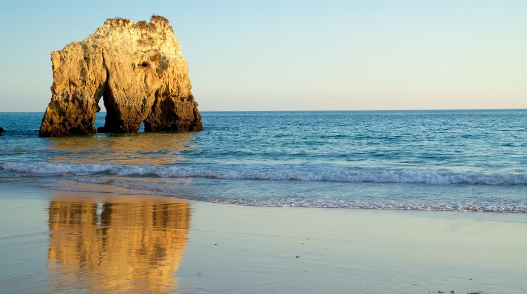 Tres Irmaos Beach featuring rocky coastline, general coastal views and a beach