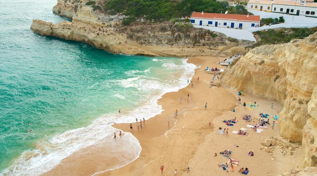 Benagil Beach which includes a sandy beach, general coastal views and rocky coastline