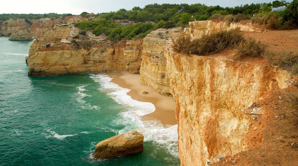 Marinha Beach which includes a sandy beach, rocky coastline and general coastal views