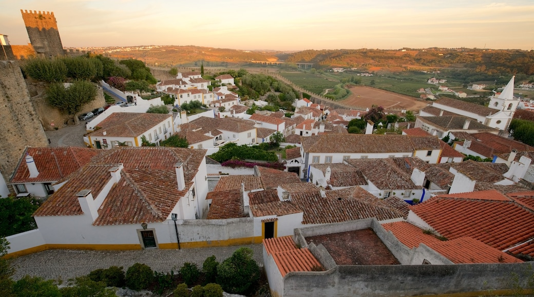 Obidos featuring a sunset, landscape views and tranquil scenes