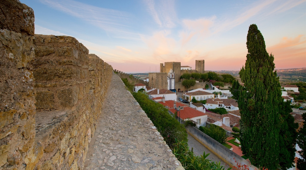 Obidos which includes a sunset
