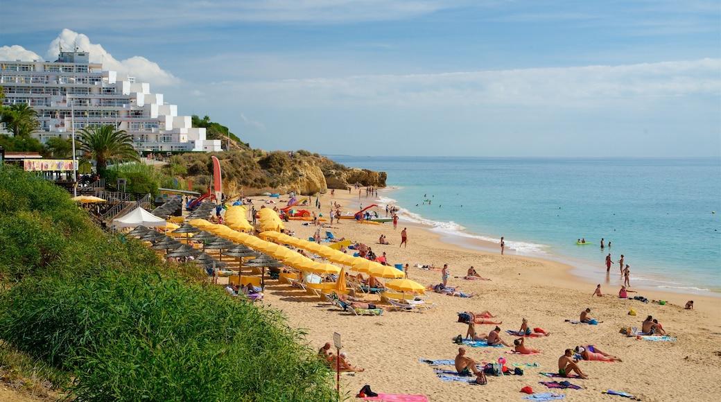 Oura Beach showing general coastal views, a coastal town and a sandy beach