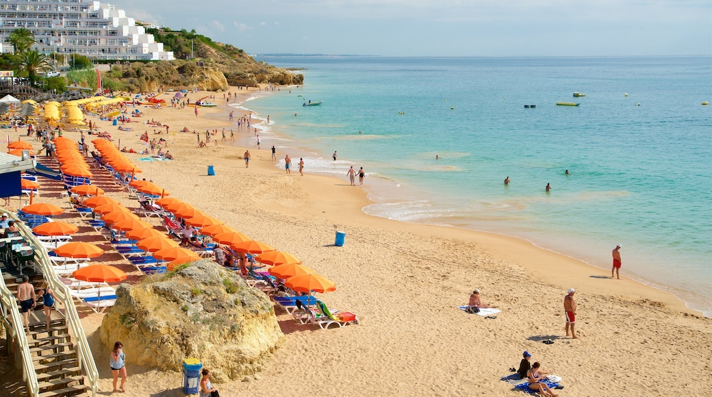 Oura Beach featuring swimming, a sandy beach and general coastal views