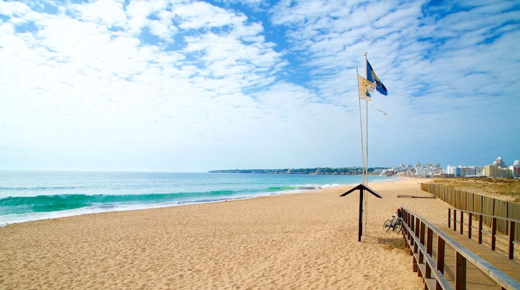 Salgados Beach showing surf, general coastal views and a beach