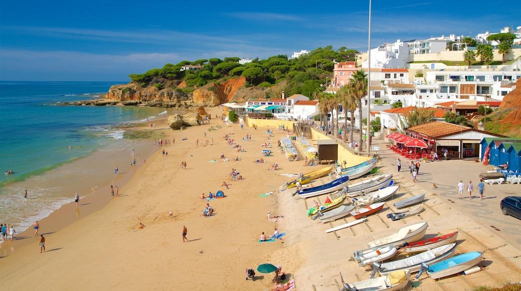 Olhos D\'Agua Beach which includes a sandy beach, general coastal views and a coastal town