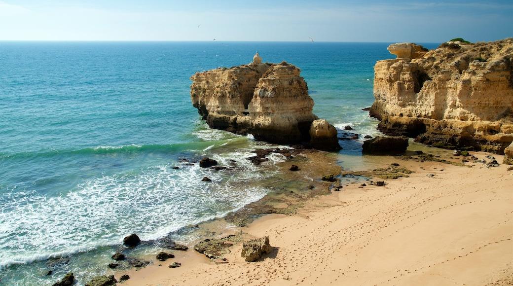 Coelha Beach showing general coastal views, a beach and rocky coastline