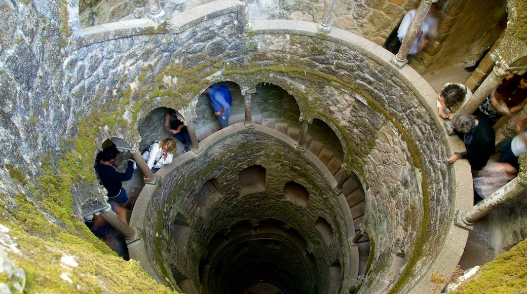 Quinta da Regaleira featuring heritage elements as well as a small group of people
