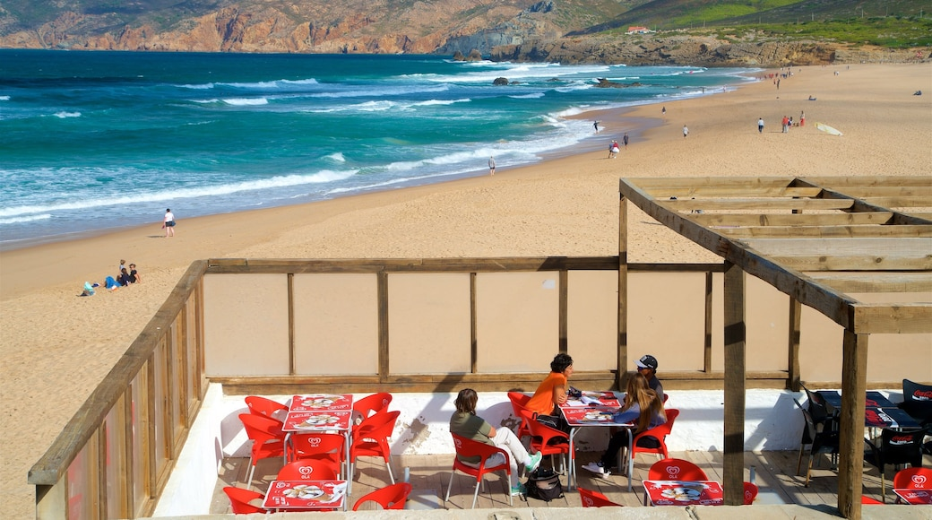 Guincho Beach which includes outdoor eating, general coastal views and a beach