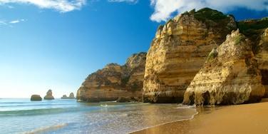 Dona Ana Beach featuring rocky coastline, a beach and general coastal views