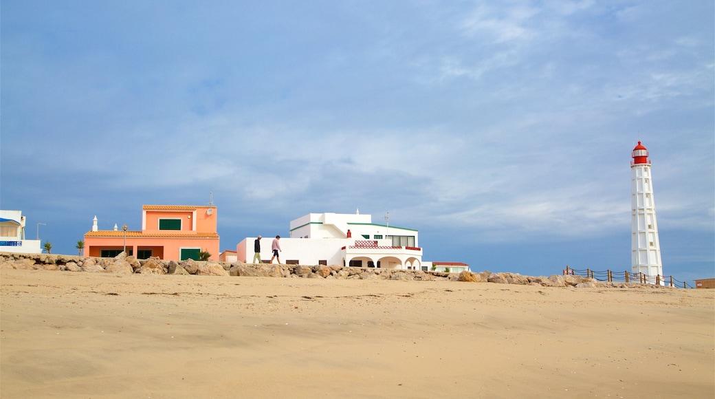 Faro Island Beach featuring a lighthouse and a beach