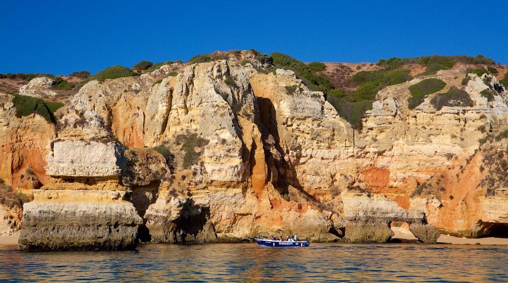 Ponta da Piedade Lagos Lighthouse showing rugged coastline, boating and general coastal views