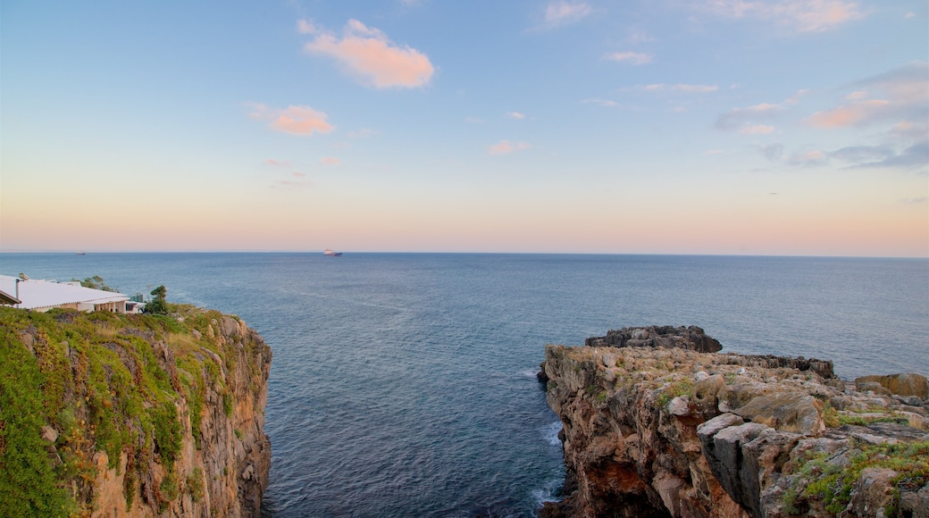 Boca do Inferno which includes general coastal views, rugged coastline and a sunset