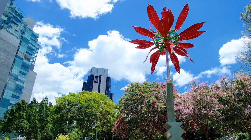 Roma Street Parkland showing a park, wild flowers and outdoor art