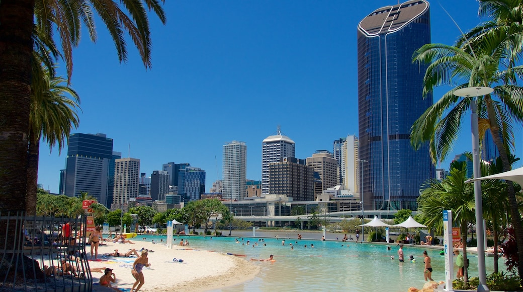Southbank Parklands featuring a pool, a beach and a high-rise building