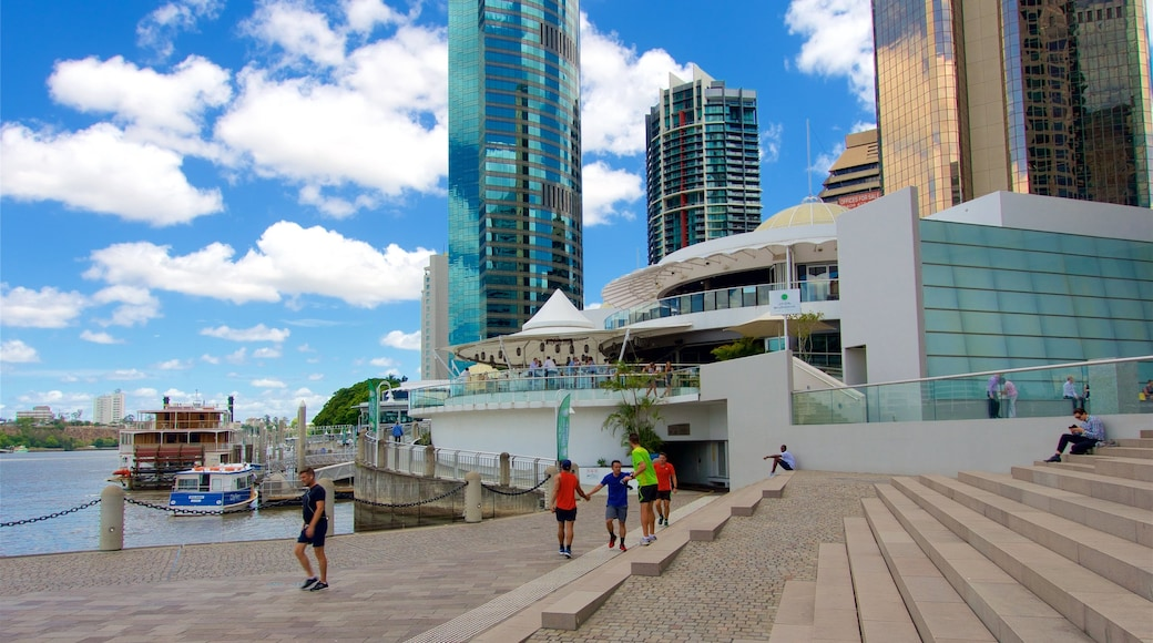 Eagle Street Pier which includes a skyscraper, a city and a river or creek