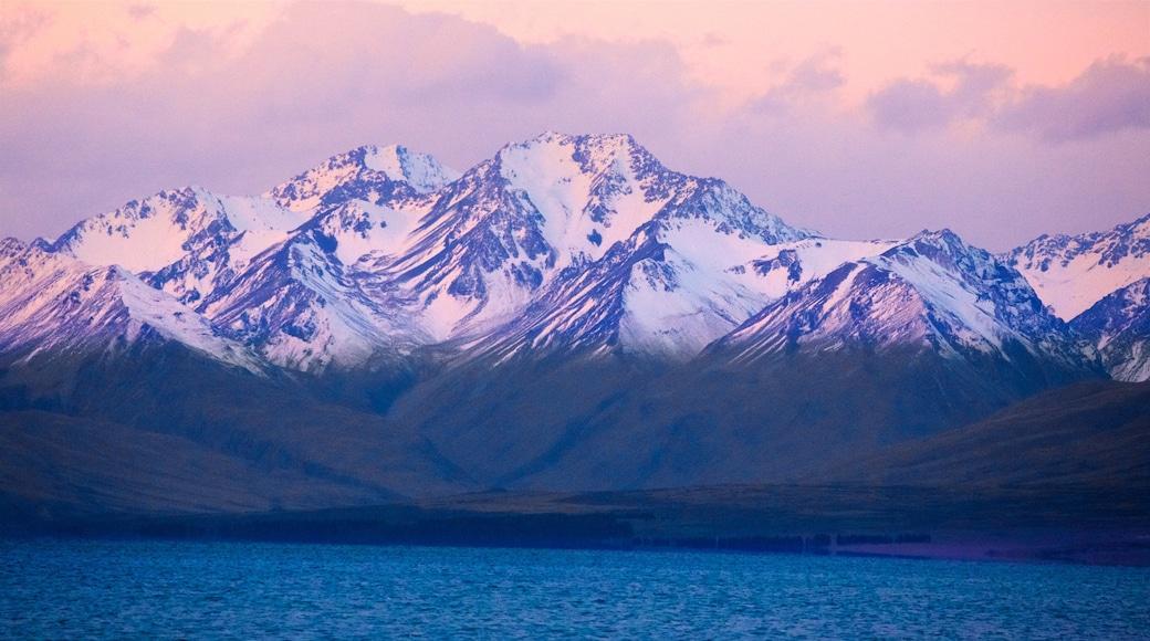 Lake Tekapo featuring mountains, snow and a sunset
