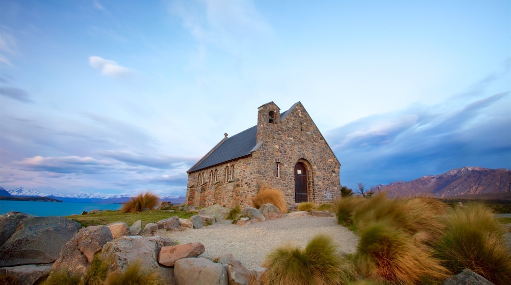 Church of the Good Shepherd showing a sunset, a church or cathedral and a lake or waterhole