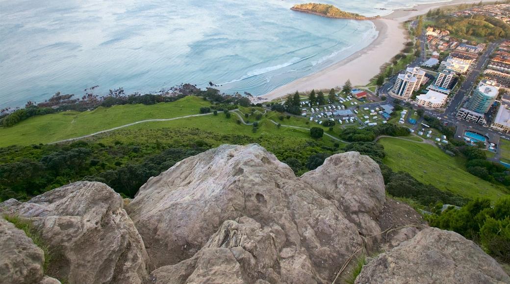Mount Maunganui showing general coastal views, a coastal town and a sandy beach