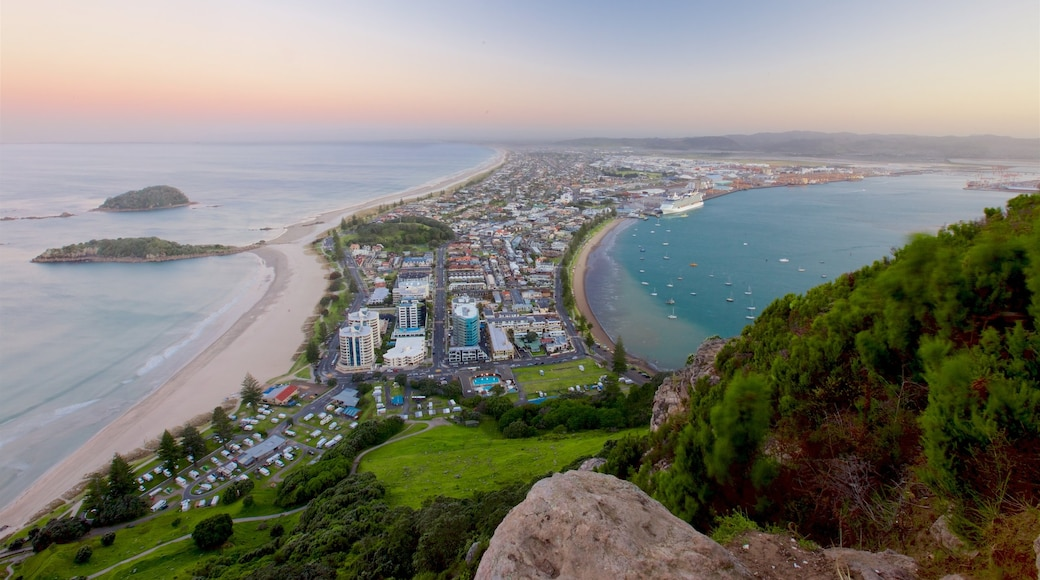 Mount Maunganui which includes a sunset, a coastal town and general coastal views