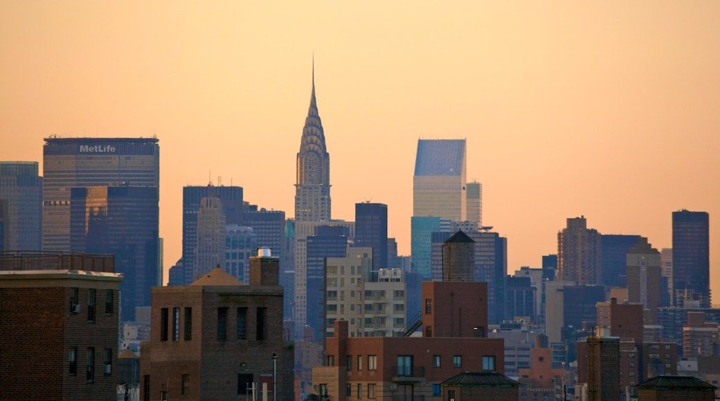 Chrysler Building featuring landscape views, a high-rise building and a sunset