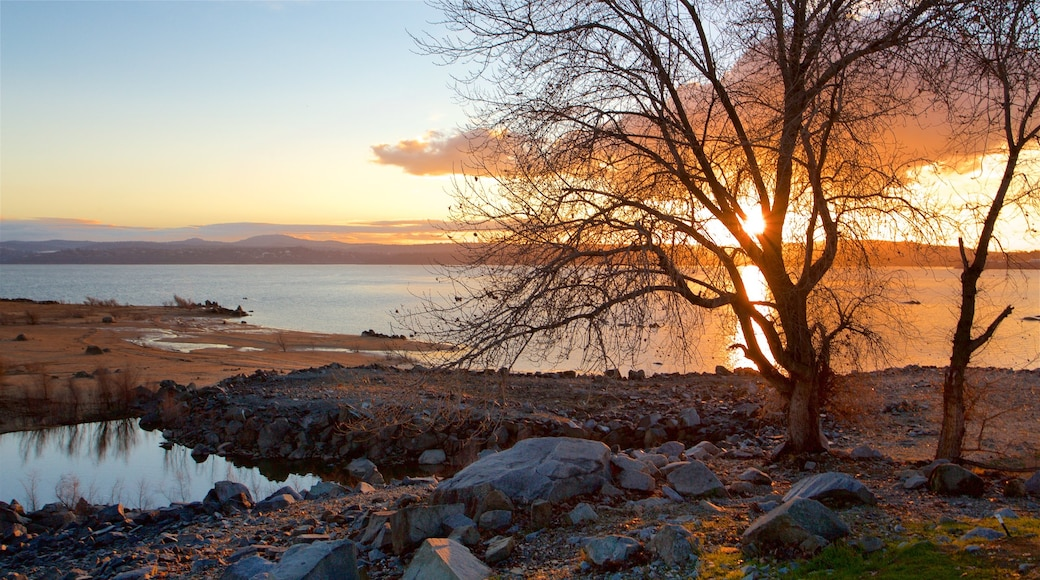 Folsom Lake State Recreation Area featuring a sunset and a lake or waterhole