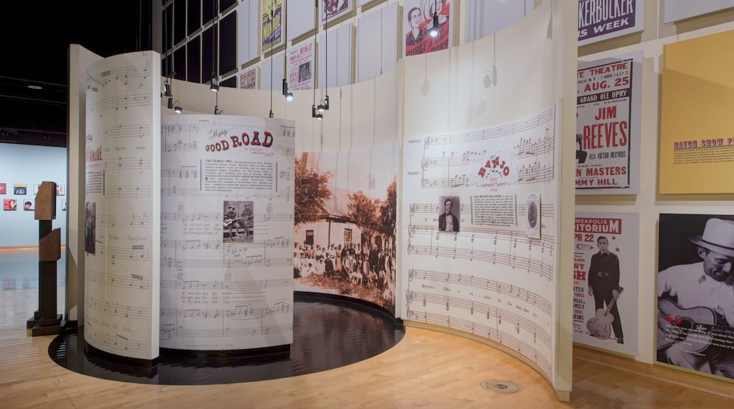 Country Music Hall of Fame and Museum featuring art and interior views