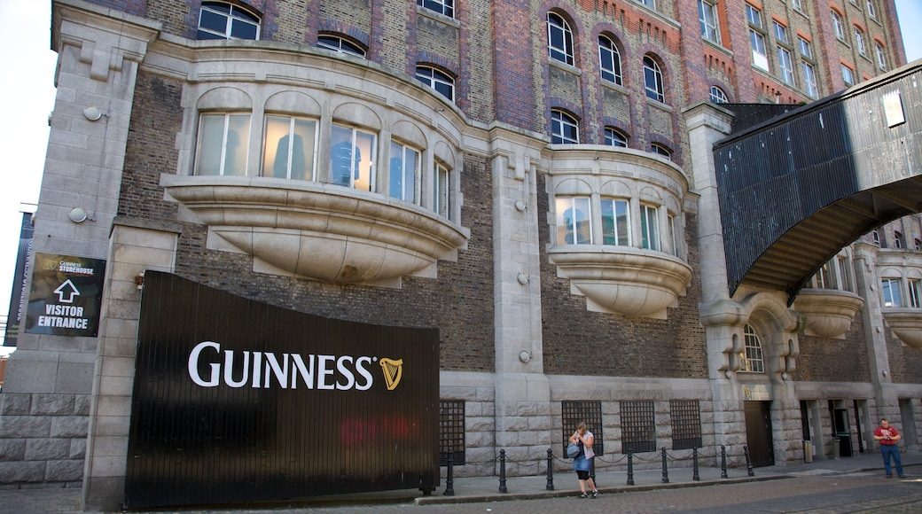 Guinness Storehouse featuring signage, heritage architecture and a city