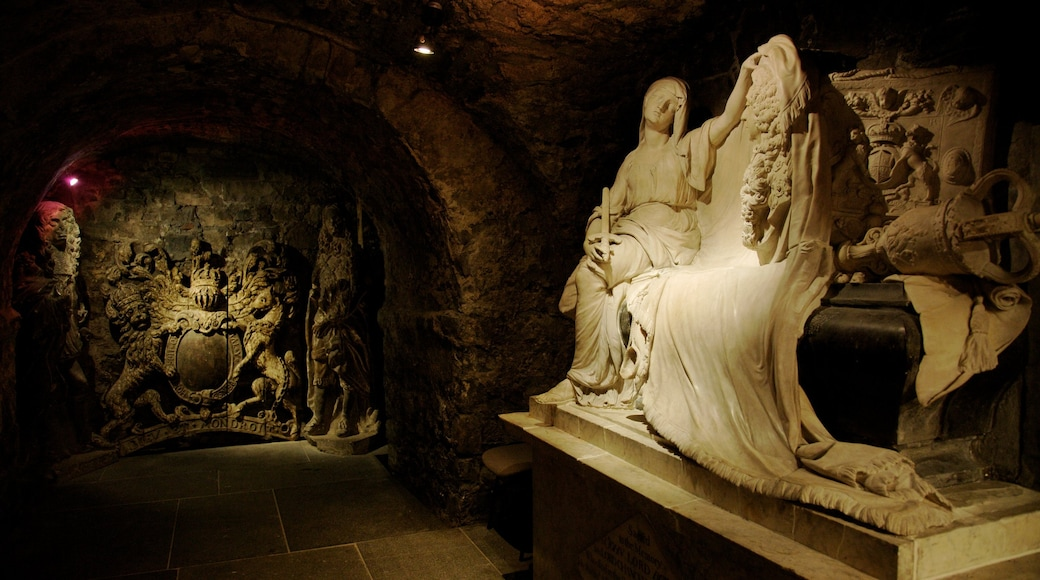 Christ Church Cathedral featuring a statue or sculpture, religious elements and interior views