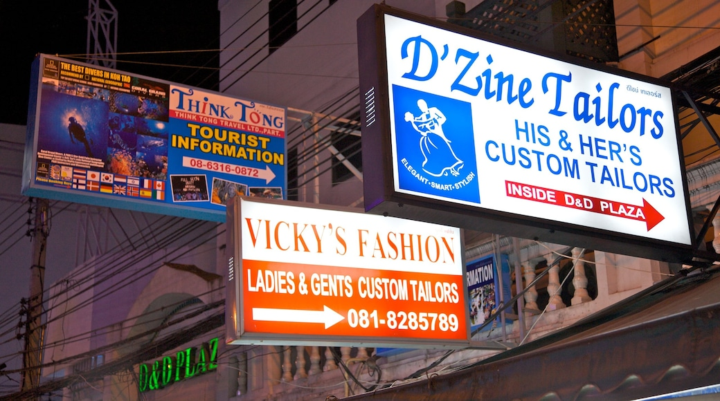 Khao San Road which includes night scenes, signage and shopping