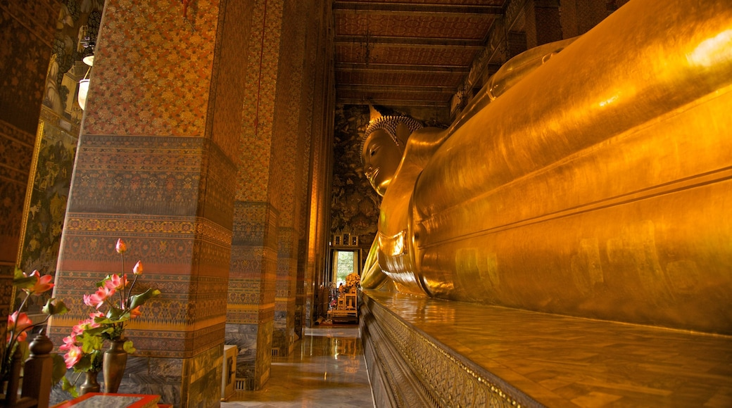 Wat Pho which includes interior views, religious aspects and a temple or place of worship