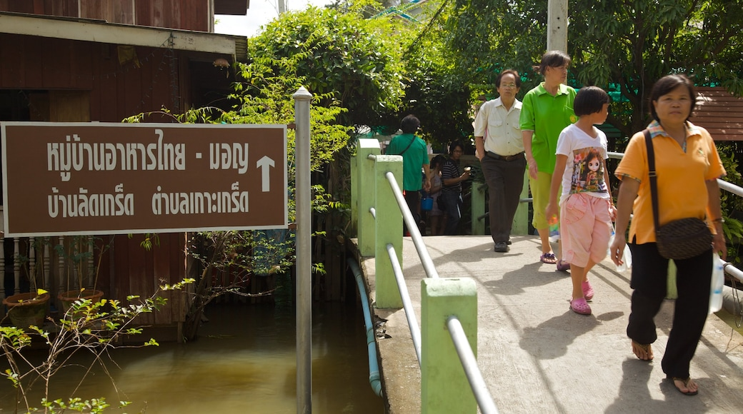 Ko Kret Island which includes hiking or walking, a bridge and a pond