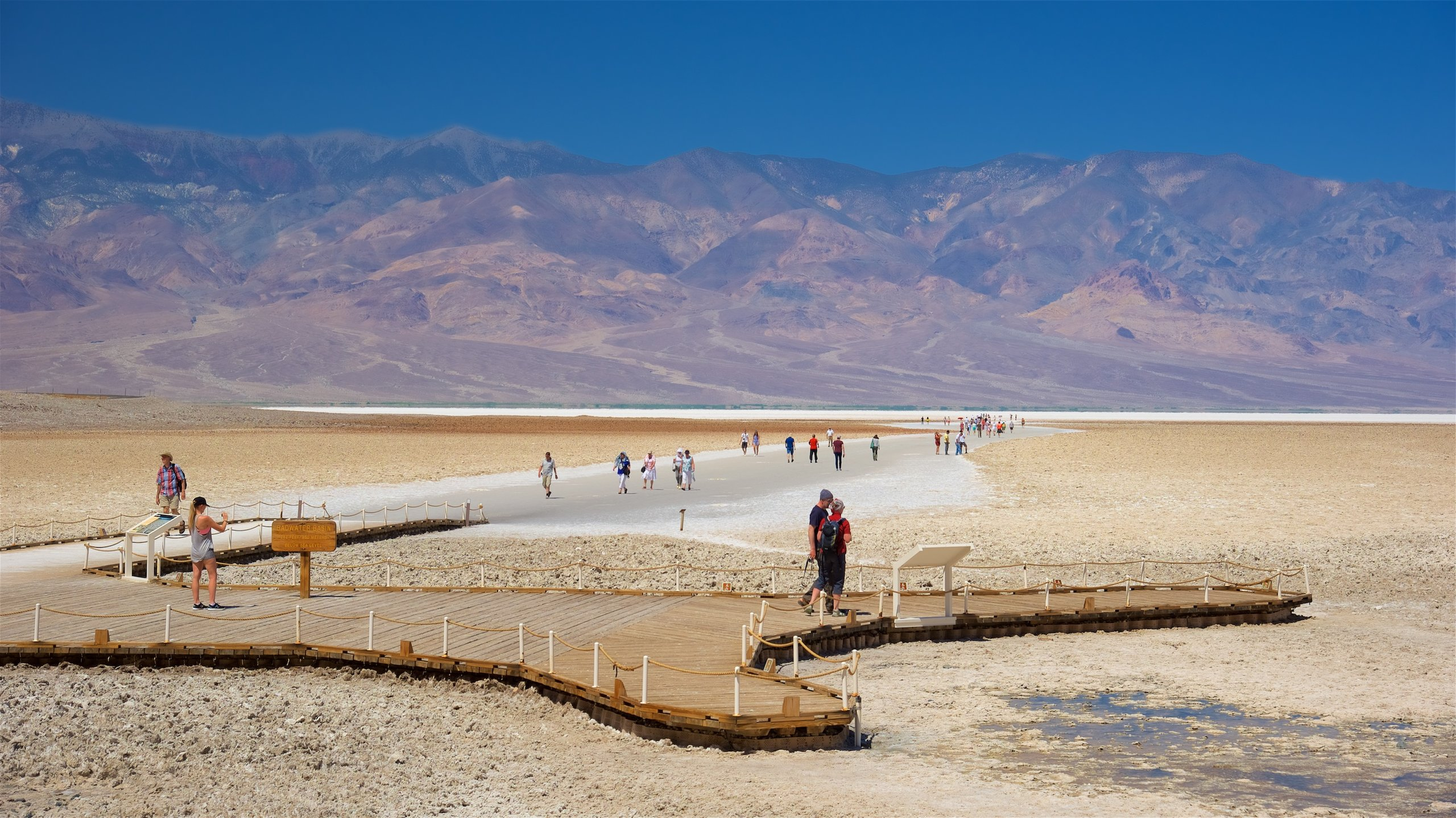 Stand on the lowest elevation in North America when you visit this spectacular salt flat beside the Black Mountains in the heart of Death Valley.