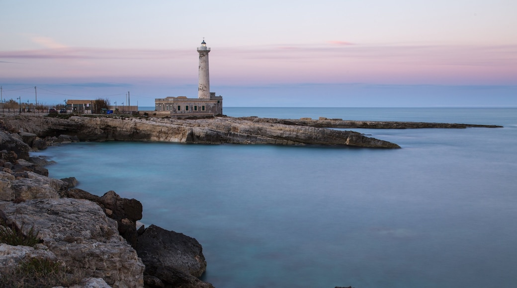 Augusta which includes a lighthouse, rocky coastline and a sunset