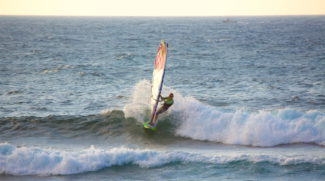 Hookipa Beach Park which includes kite surfing, general coastal views and a sunset