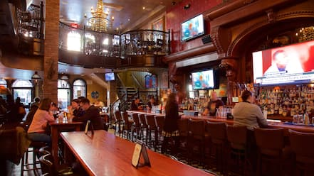 Hell\'s Kitchen featuring a bar, interior views and dining out