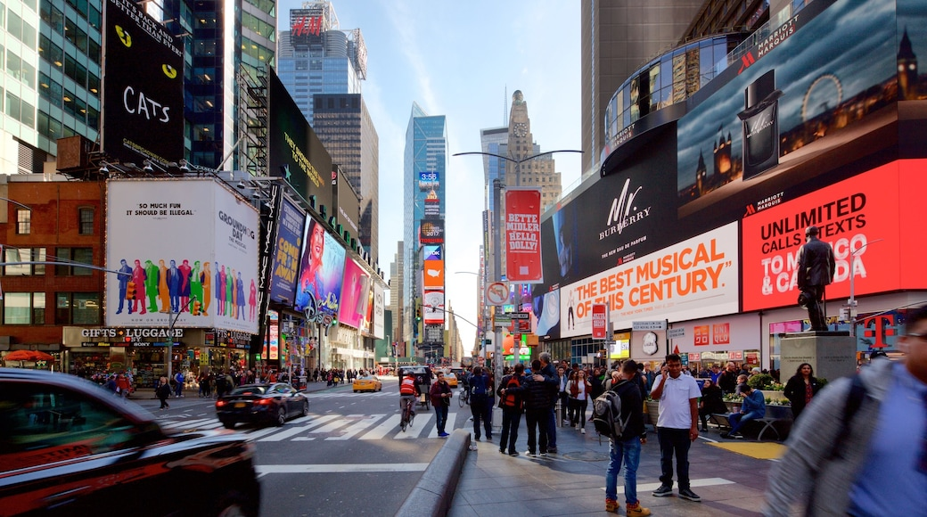 Times Square which includes a high rise building, city views and a city