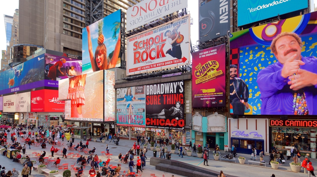 Times Square featuring signage, a city and central business district