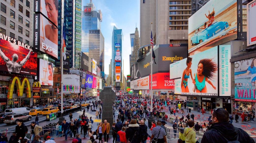 Times Square montrant gratte-ciel, signalisation et ville