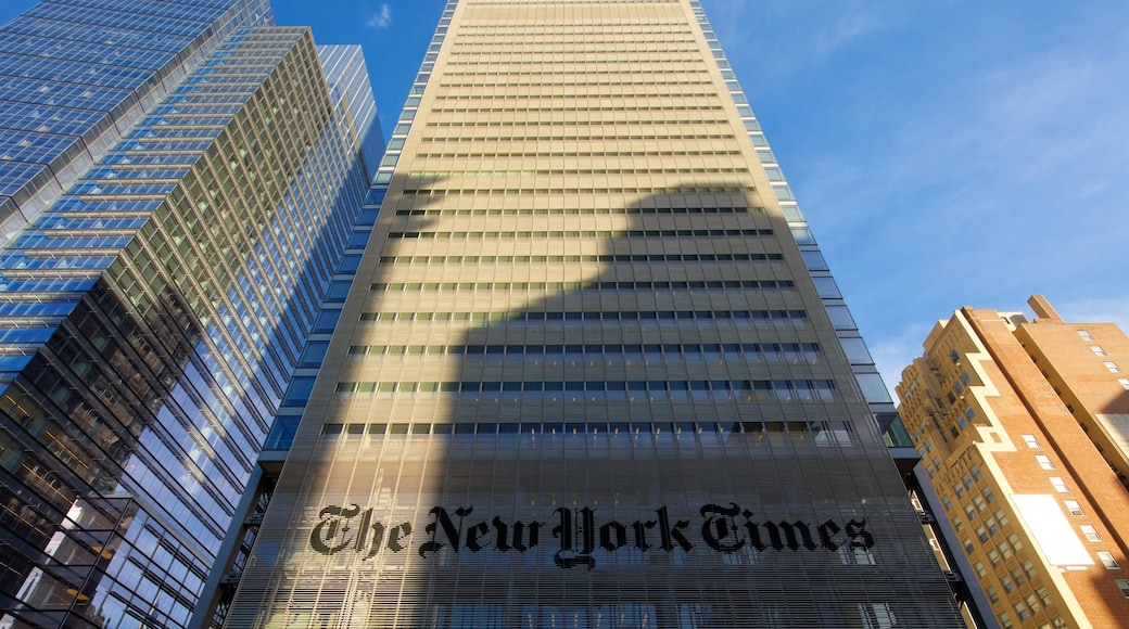New York Times Building showing a high rise building, signage and a city