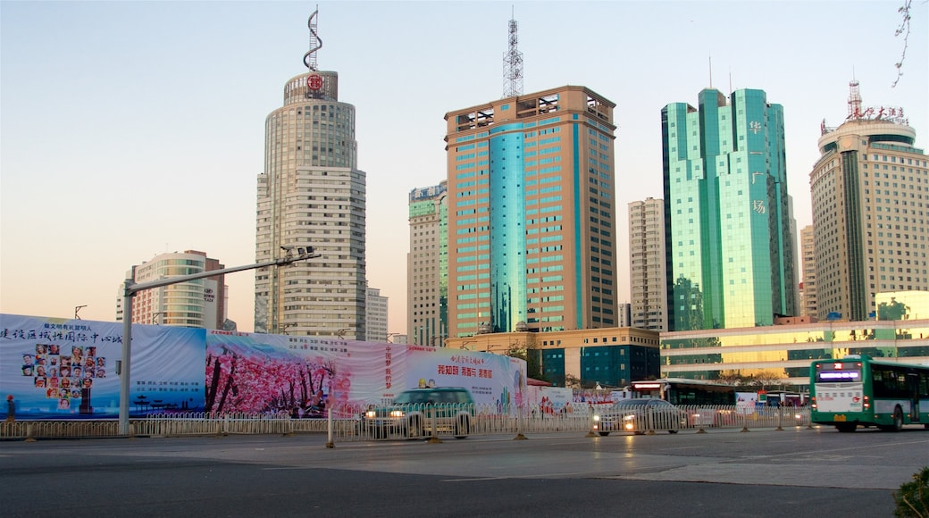Kunming which includes a sunset, a city and a high-rise building