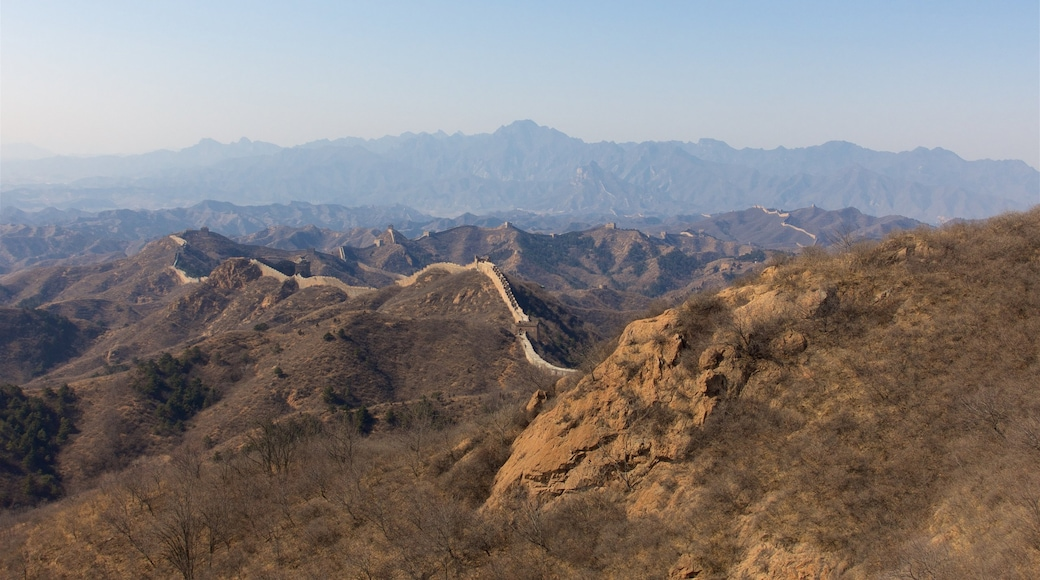 Jinshanling Great Wall which includes landscape views, tranquil scenes and a sunset