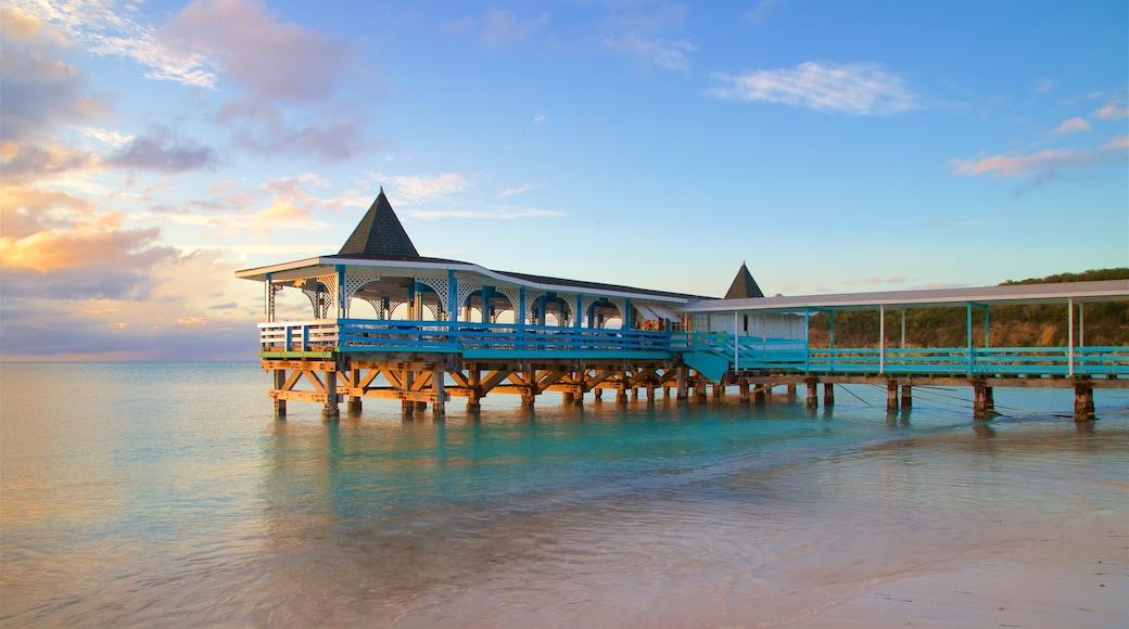 Dickenson Bay Beach featuring a sunset, a beach and general coastal views