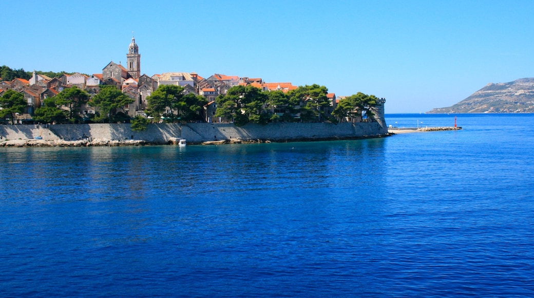 Korcula which includes a small town or village and a river or creek