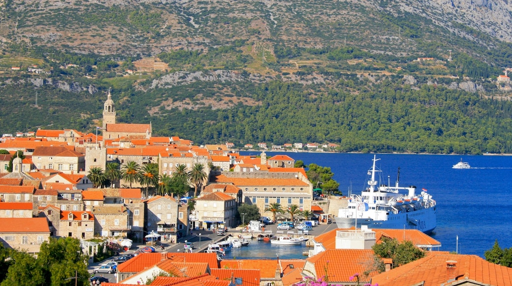 Korcula showing a small town or village and a lake or waterhole